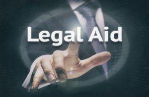 48085103 - businessman pressing a legal aid concept button.